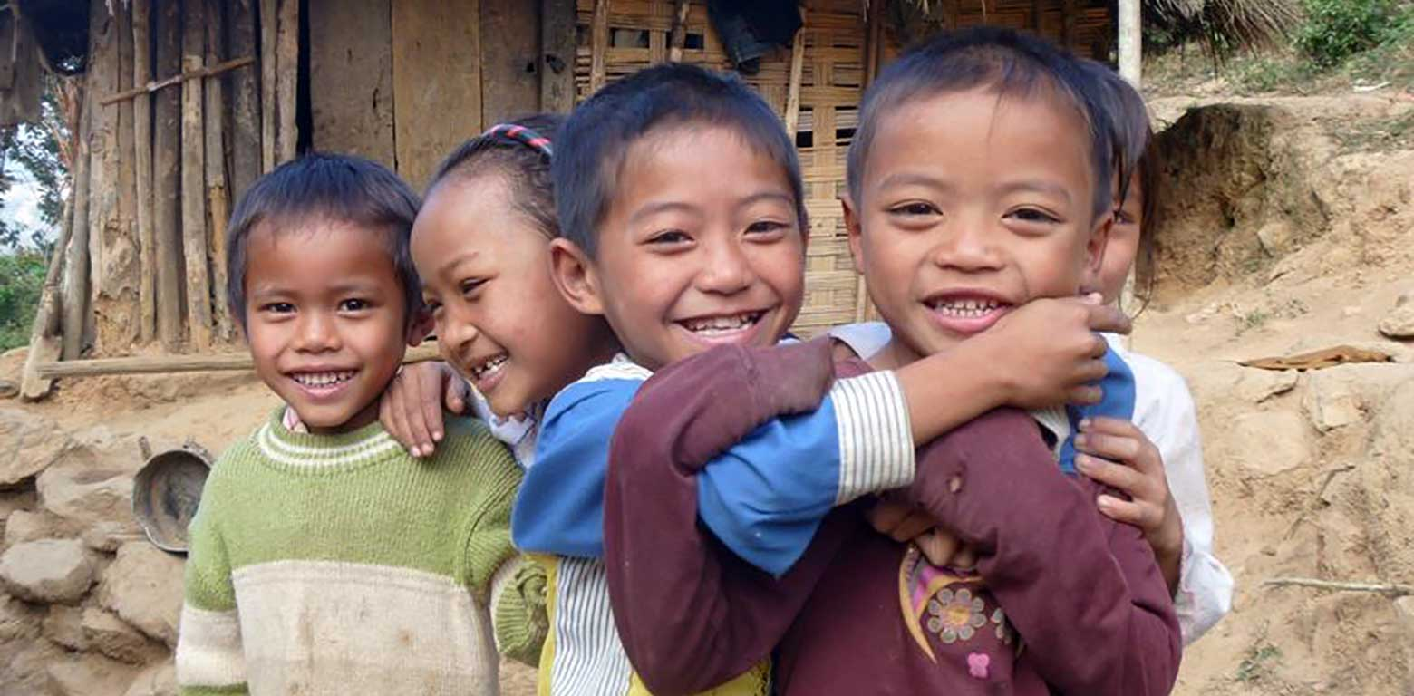 Leave a legacy - Help children in crisis in Vietnam (Image - Rural Vietnamese children laughing and hugging)